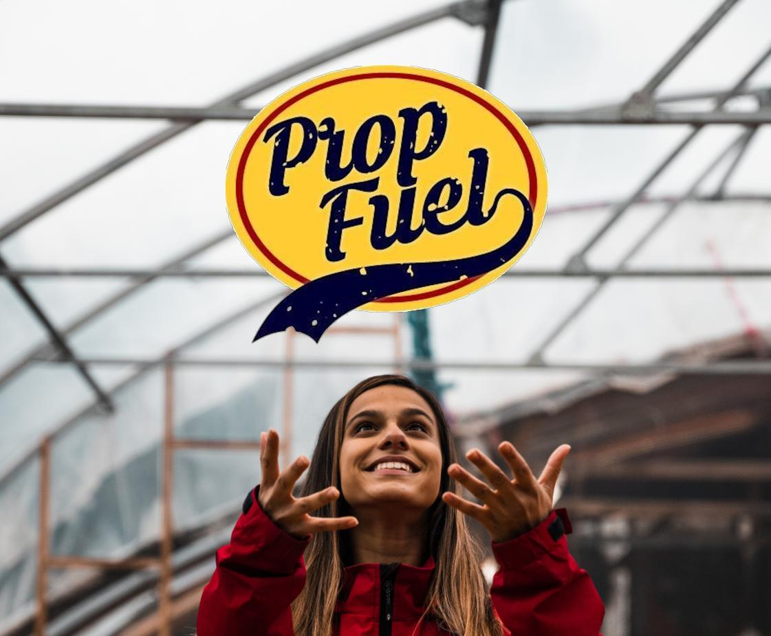 woman happily catching a PropFuel logo